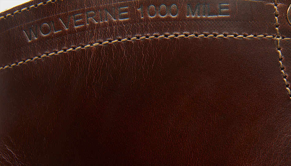 A part of leather with sign Wolverine 1000 Mile.