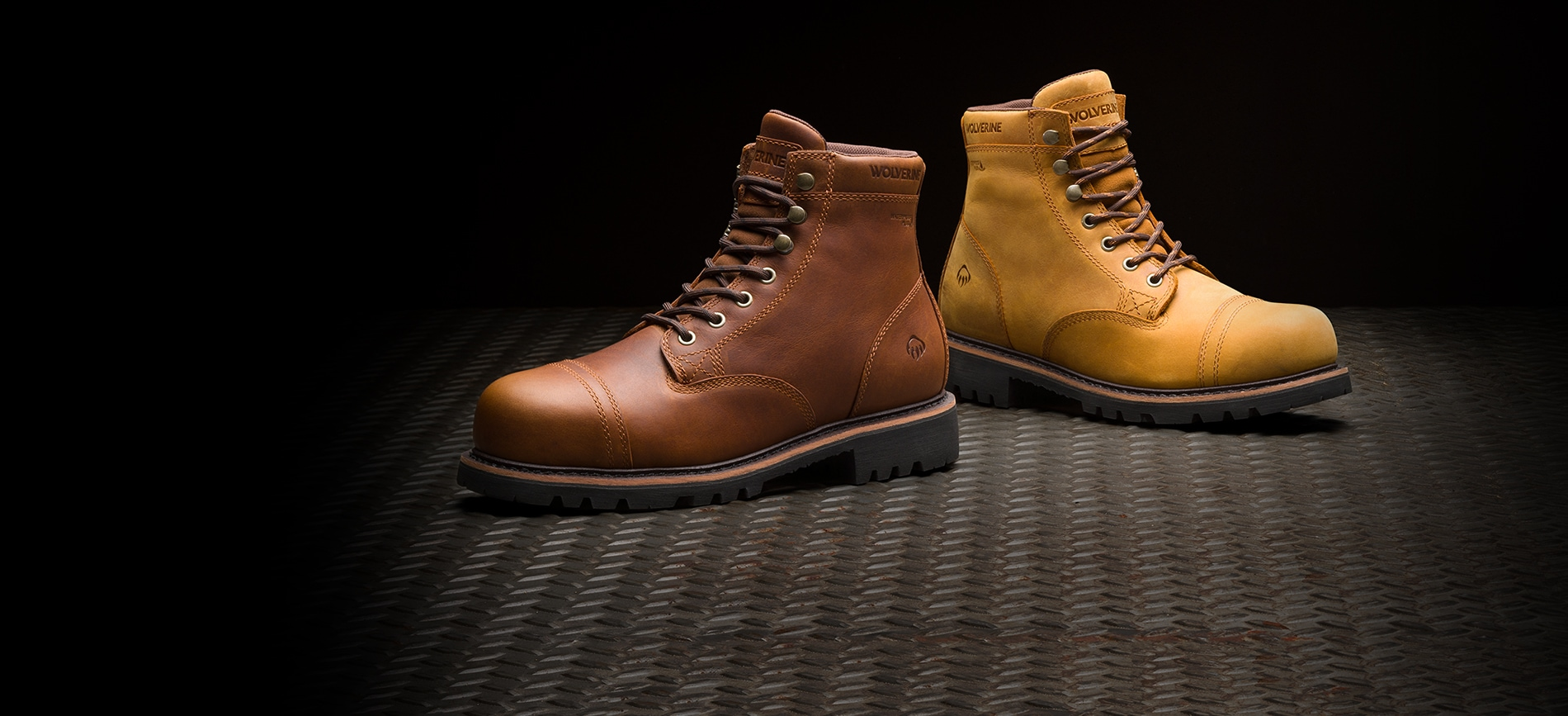 2 Colors of the Journeyman boot sitting on a steel surface