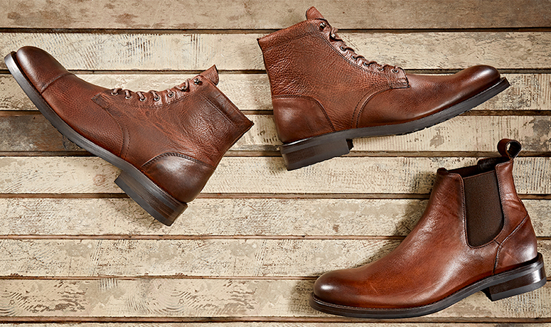 Wolverine BLVD Cap Toe in tan by a log.