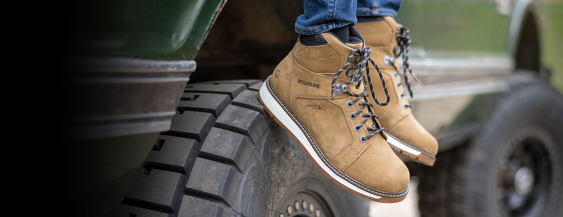 Ultraspring work boots sitting on a tire.