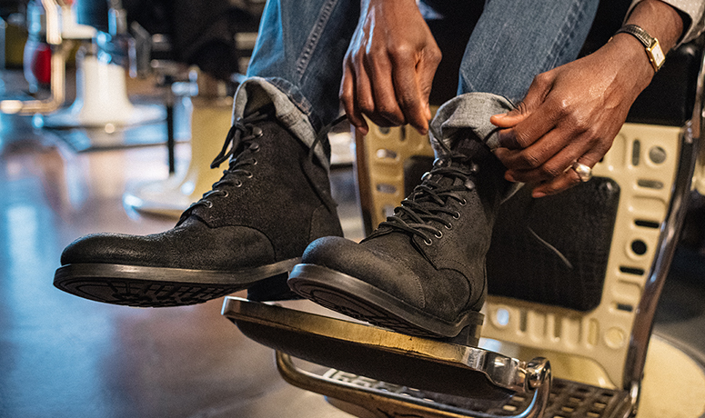 Wolverine BLVD Cap Toe in black on a barber's chair being tied.