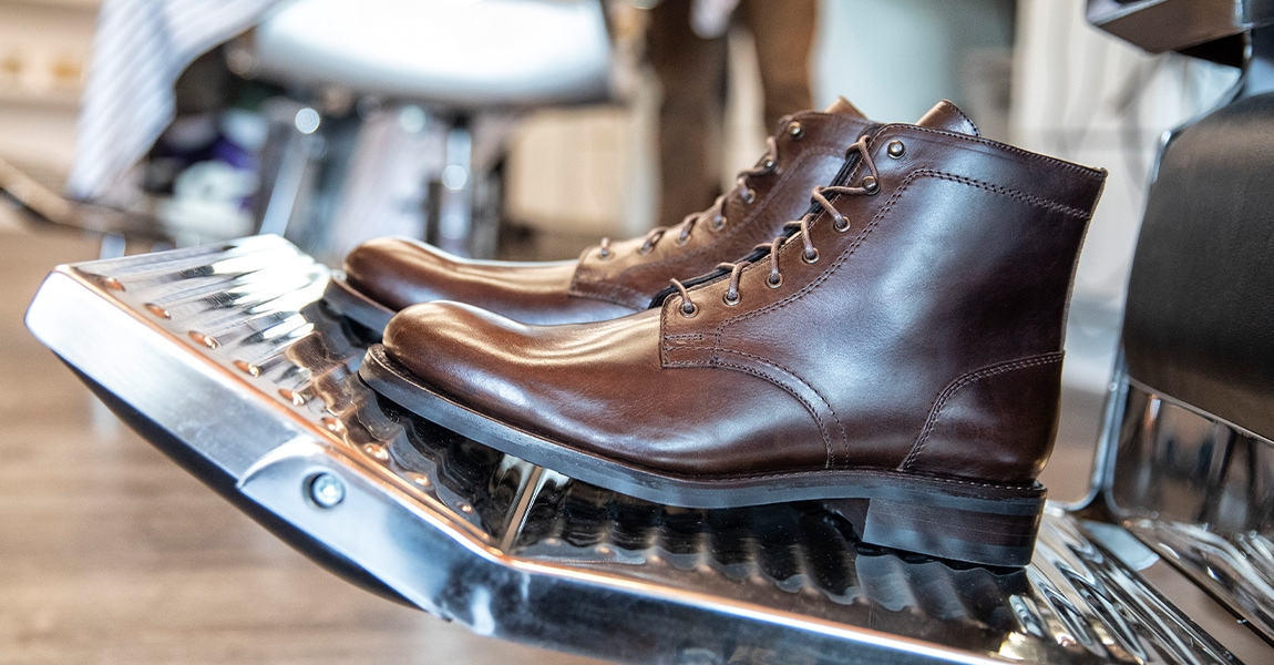Wolverine BLVD Plain Toe in brown on a barber stool