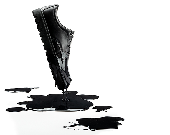 Shoe dripping with black ink