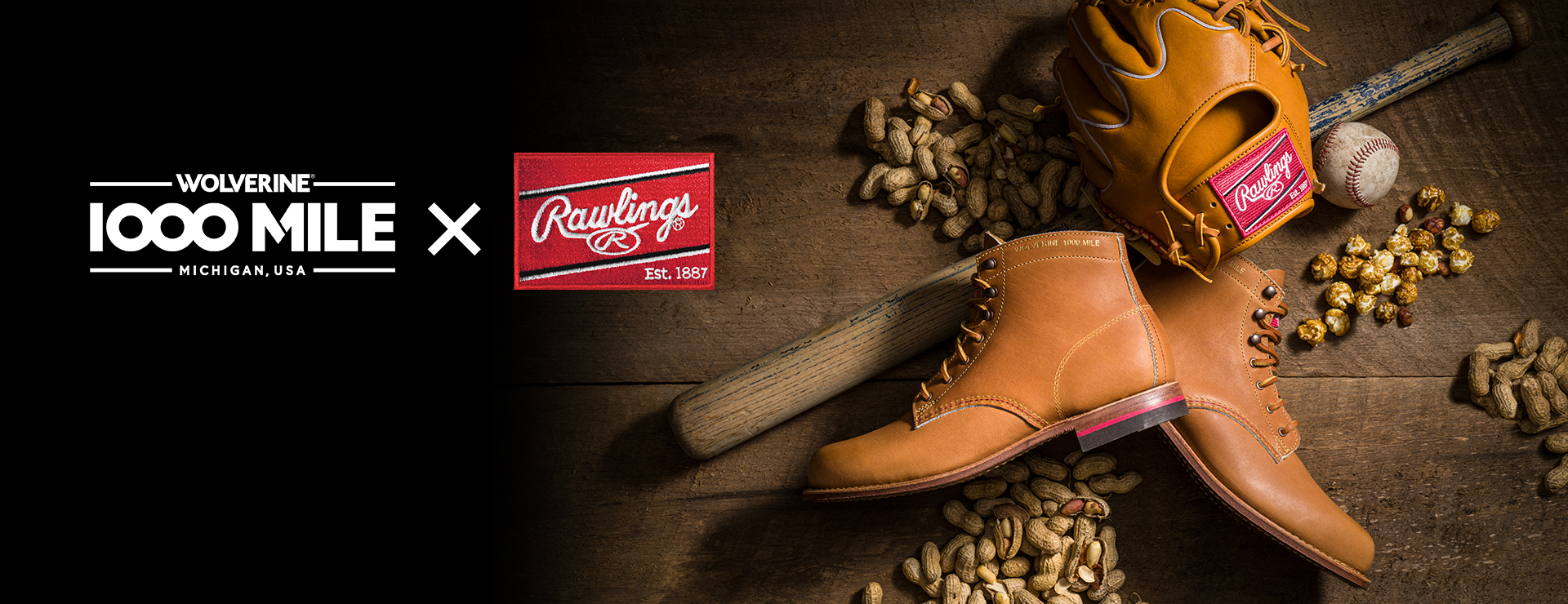 The new 1000 mile X Rawlings work boots laying on a pile of peanutes next to a baseball mitt.