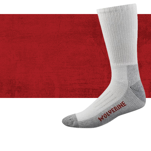 A white, calf-length sock with grey heel & toe. The underside is the red on grey WOLVERINE brand.