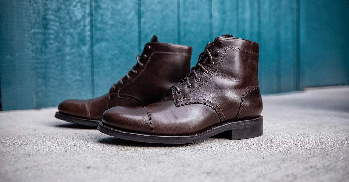 Wolverine BLVD Cap Toe in brown on a cement floor