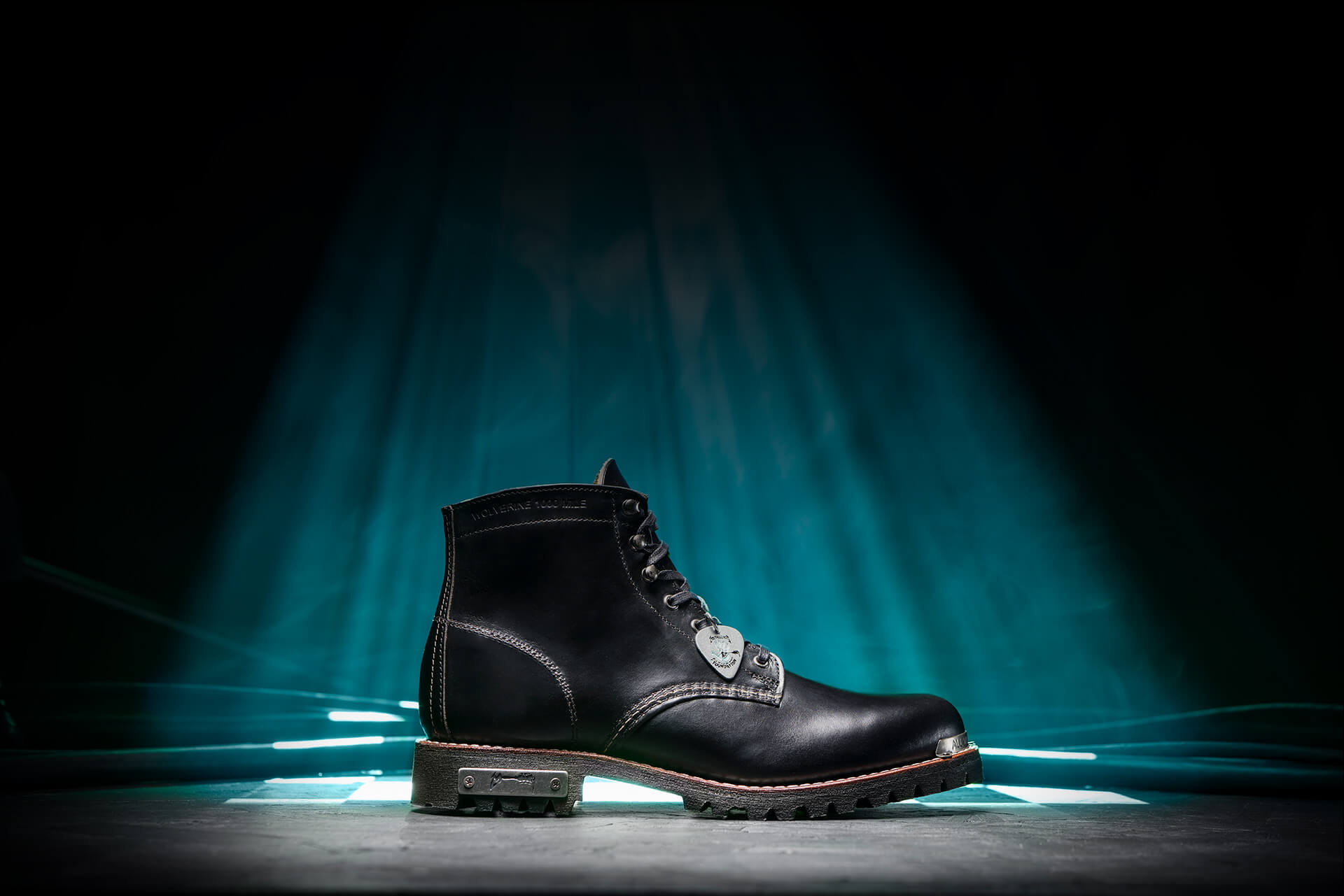 Axel boot on stage in a blue spotlight and dry ice.